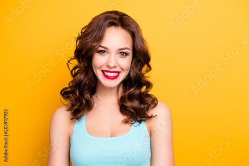 Valokuva  Portrait of charming joyful girl with modern hairdo red lipstick pomade tempting