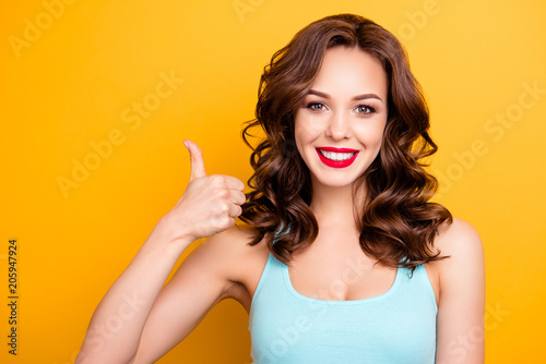 Valokuva  Portrait of positive pretty girl with beaming smile modern hairdo gesturing thum
