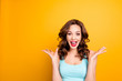Leinwanddruck Bild - Wow, yes, omg! Portrait with copy space empty place of astonished impressed girl with hairdo yelling wide open mouth isolated on yellow background having fun celebrating achievement