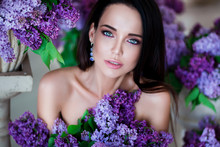 Beauty Portrait. Beautiful Woman With Sensual Lips Sitting Among Violet Flowers. Cosmetics, Make-up. Perfumery.