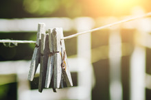 Old Wooden Clothespins Hang On...
