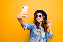Portrait Of Cool Cheerful Girl Having Video-call With Lover Holding Smart Phone In Hand Shooting Selfie On Front Camera Isolated On Yellow Background Enjoying Weekend Vacation