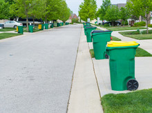 Row Of Garbage Bins Lined Up A...
