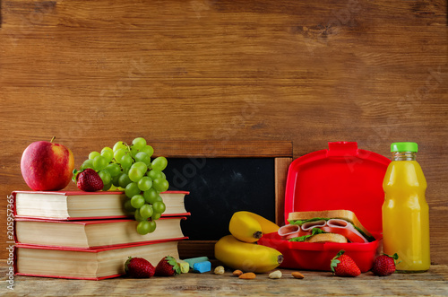 Foto op Aluminium Assortiment school lunch with a sandwich, fresh fruits and juice