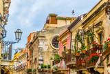 Fototapeta Uliczki - View of a narrow street in Taormina, Sicily, Italy