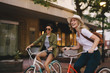 canvas print picture - Female friends enjoying bicycle ride