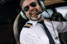 Smiling Helicopter Pilot With ...