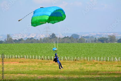 Woman parachute landing