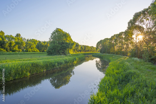 Recess Fitting Channel Canal in the countryside in the light of sunrise in spring
