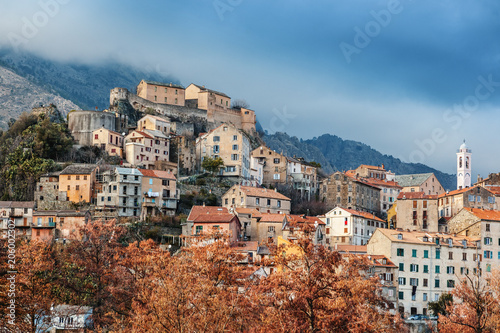 Fotografie, Obraz  Corte, a beautiful city in the mountains on the island of Corsica, a view of the