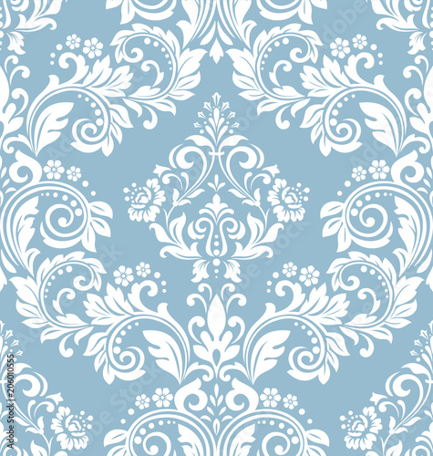 Wallpaper in the style of Baroque. A seamless vector background. White and blue floral ornament. Graphic pattern for fabric, wallpaper, packaging. Ornate Damask flower ornament