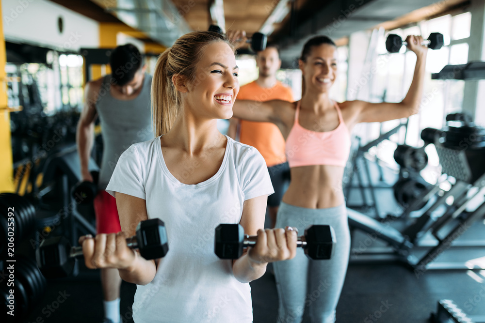 Fototapety, obrazy: Picture of two fitness women in gym