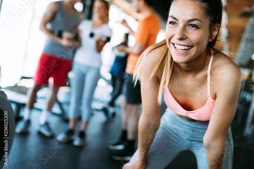 Photo Stands Fitness Close up image of attractive fit woman in gym