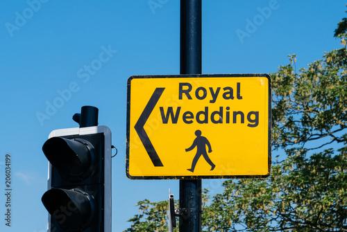 Fotografie, Tablou Royal Wedding yellow street sign with arrow for pedestrians to follow to marriag