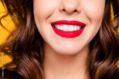 Close up half face portrait of toothy woman with beaming  smile red lips white s Fototapet