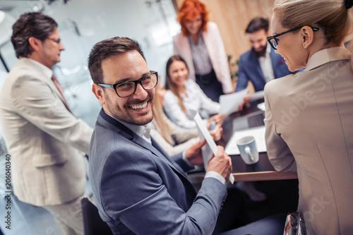 Obraz Business people having meeting in modern office - fototapety do salonu