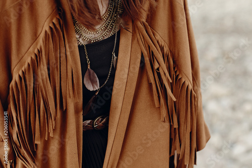 Keuken foto achterwand Boho Stijl stylish hipster boho traveler woman look. gypsy girl in fringe jacket with feather bronze accessory. wanderlust summer travel. atmospheric moment. space for text.