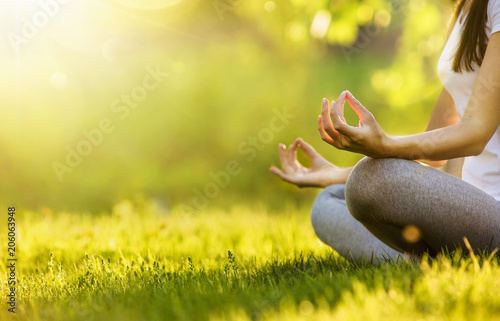 Fotobehang School de yoga Yoga woman meditating at sunset. Female model meditating in serene harmony