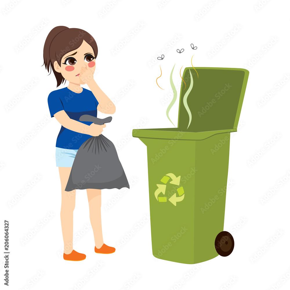 Fototapeta Woman holding stinky trash bag and throwing it on recycle bin