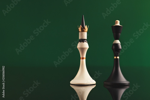 Photo  Pair of king chess pieces confronted as opposites