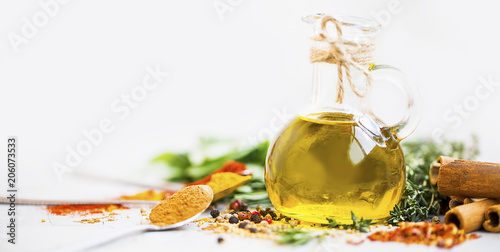 Fototapeta Olive oil with spices and herbs obraz