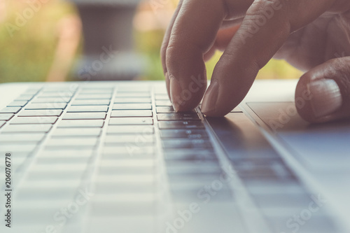 Fototapety, obrazy: man hand using on computer laptop in a coffee shop, technology background