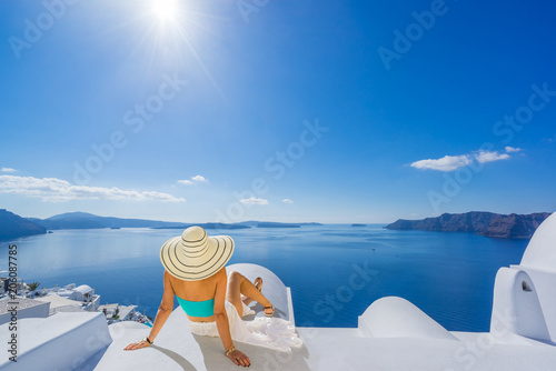 Woman on Santorini's roof top