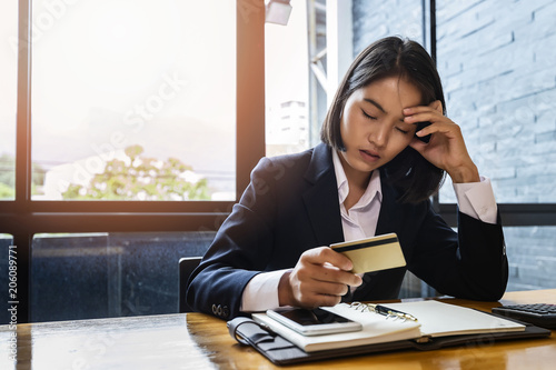 Valokuva  Stressful asian businesswoman with huge amount of credit card debt