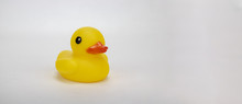 A Yellow Rubber Duck On An Isolated White Background With Room For Text And Other Objects!