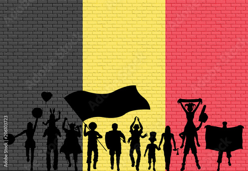 Fotografía  Belgian supporter silhouette in front of brick wall with Belgium flag