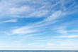 Leinwanddruck Bild - Beautiful blue sky over the sea with translucent, white, Cirrus clouds