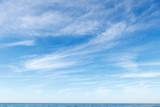 Fototapeta Na sufit - Beautiful blue sky over the sea with translucent, white, Cirrus clouds
