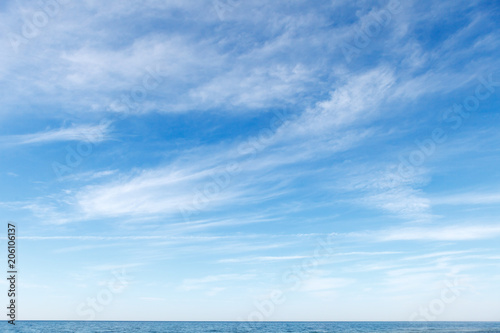 Beautiful blue sky over the sea with translucent, white, Cirrus clouds - 206106137