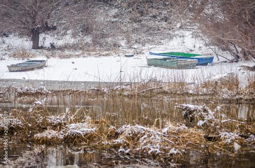 Foto op Plexiglas Cappuccino Drawn wooden boats on the lake shore