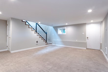 Light Spacious Basement Area With Staircase.