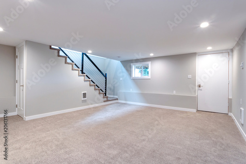 Light spacious basement area with staircase. Canvas Print