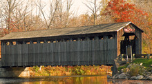 A Photograph Of An Historic Covered Bridge In Central Michigan