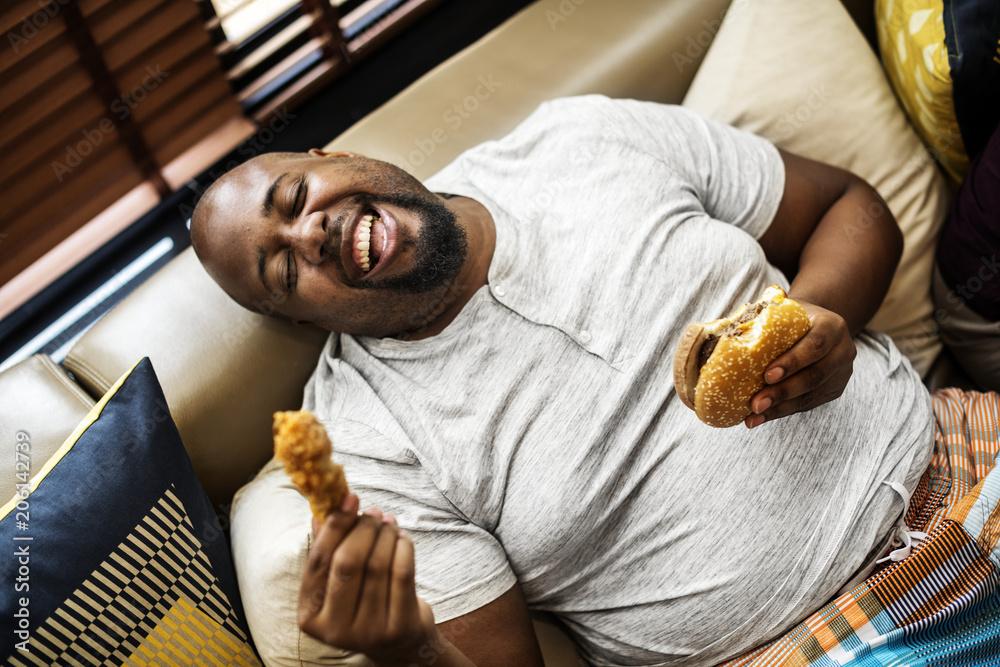 Fototapety, obrazy: Man eating a big hamburger