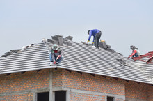 Workers Installing Concrete Ti...