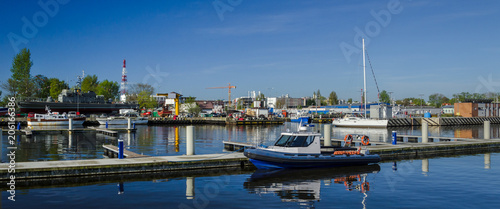 Deurstickers Poort MARINA - Police motorboat and yachts on the port wharf in Kolobrzeg