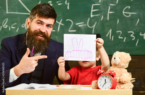 teacher and pupil in mortarboard chalkboard on background father