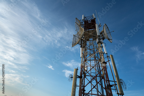 Fotografie, Tablou  Telecommunications antenna for radio, television and telephone with blue sky