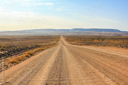 Fotografie, Obraz  Gravel road to the Fish River Canyon, south of Namibia, Africa