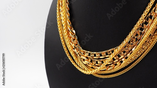 Foto  group of gold necklace isolated on white background
