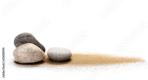 Stampa su Tela  Sea stones in sand pile isolated on white background