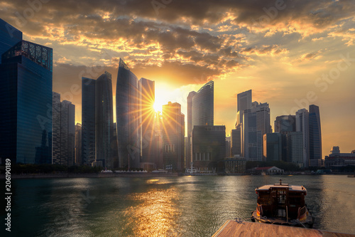 Plagát  Evening sunset on Marina bay in Singapore city with wooded boat and waterfront