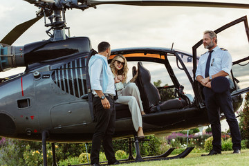 Fototapeta Couple traveling by a private helicopter