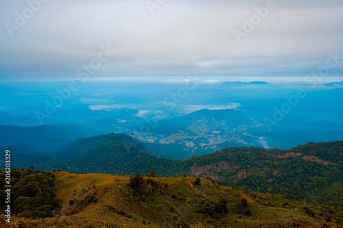 Spoed Foto op Canvas Blauwe jeans high mountains peaks range clouds in fog scenery landscape national park view outdoor at Chiang Rai, Chiang Mai Province, Thailand