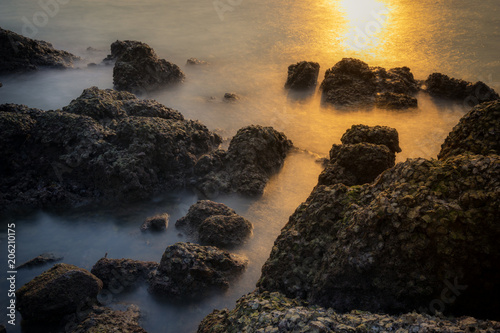 Photographie  surreal of seascape between of sunset and night with long exposure