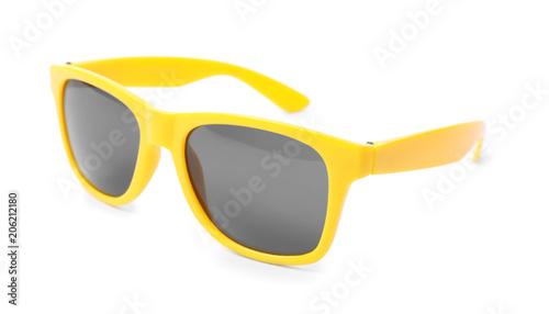 Beautiful sunglasses on white background. Beach object